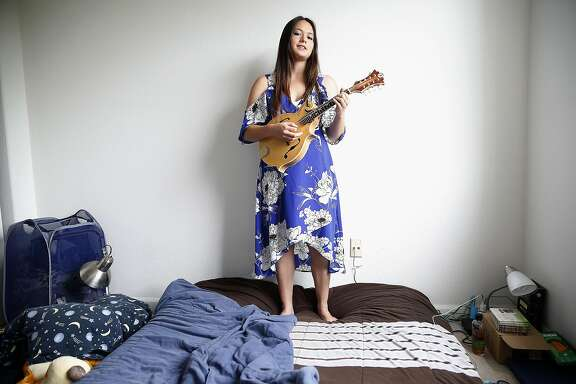 AJ Lee, 19 year old singer, mandolinist, fiddler and guitarist from Santa Cruz plays music in her room on Thursday, June 8, 2017, in Santa Cruz, Calif.  The California Bluegrass Association is going to have a float in the SF Pride parade with AJ Lee's bluegrass band.