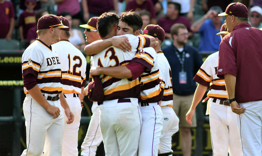 Deer Park senior pitcher Adrian Gonzales, center, gets a hug from senior shortstop Josiah Ortiz (13) after closing out the Deer's 3-2 win over Southlake Carroll in their 2017 Class 6A UIL Baseball State Championship semifinal matchup at Dell Diamond in Round Rock on Friday, June 9, 2017. (Photo by Jerry Baker/Freelance) Photo: Jerry Baker/For The Chronicle