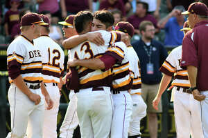 Deer Park senior pitcher Adrian Gonzales, center, gets a hug from senior shortstop Josiah Ortiz (13) after closing out the Deer's 3-2 win over Southlake Carroll in their 2017 Class 6A UIL Baseball State Championship semifinal matchup at Dell Diamond in Round Rock on Friday, June 9, 2017. (Photo by Jerry Baker/Freelance)