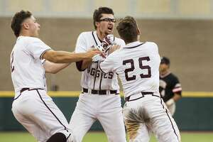 Texas A&M's George Janca, center, Tim Lichty (2) and Austin Homan (25) celebrate Janca's RBI walk off single off Davidson reliever Westin Whitmire for a 7-6 win in 15 innings during the NCAA baseball Super Regional at Olsen Field at Blue Bell Park on Friday, June 9, 2017, in College Station. ( Brett Coomer / Houston Chronicle )