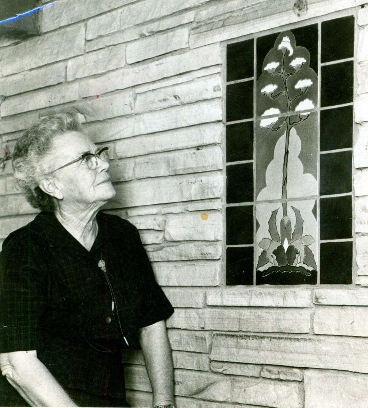 San Jose pottery founder Ethel Wilson Harris looks at a tile maguey mural that was the trademark of the workshop.