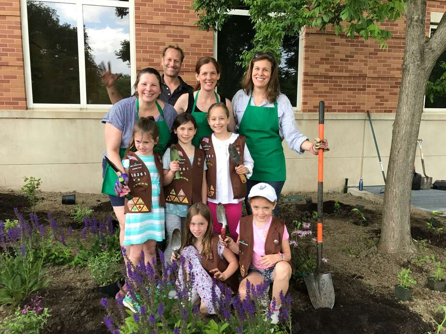 Second-graders in Girl Scout Troop #50361 have donated a butterfly garden to the Carl and Dorothy Bennett Community Garden at Greenwich Hospital. The 9-year-olds were on hand last week to plant the butterfly garden under the supervision of John Huber, the Greenwich Hospital landscape architect. The troop donated $1,400 for the garden – money raised from selling more than 1,500 boxes of Girl Scouts cookies.  Planting the butterfly garden in the Carl and Dorothy Bennett Community Garden at Greenwich Hospital were John Huber, the hospital's landscape architect, and Girl Scouts Brownie Troop #50361 members, including leaders Nina Bliley, Pamela Frame and Lilly Armstrong along with scouts (standing) Isabela Bliley, Kate Culvahouse and Charlotte Armstrong and (kneeling) Caroline Stickle and Josie Frame. Photo: Contributed