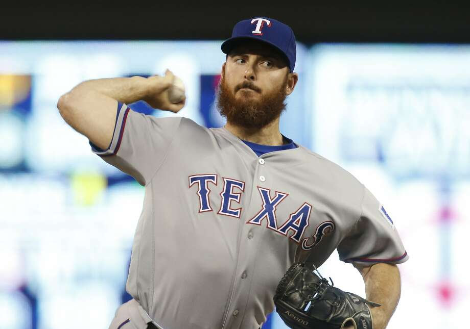 FILE - In this Friday, July 1, 2016 file photo, Texas Rangers relief pitcher Sam Dyson throws against the Minnesota Twins in the tenth inning of a baseball game in Minneapolis. The Texas Rangers have traded Sam Dyson to the San Francisco Giants less than a week after the struggling reliever was designated for assignment, Tuesday, June 6, 2017. (AP Photo/Jim Mone, File) Photo: Jim Mone, Associated Press