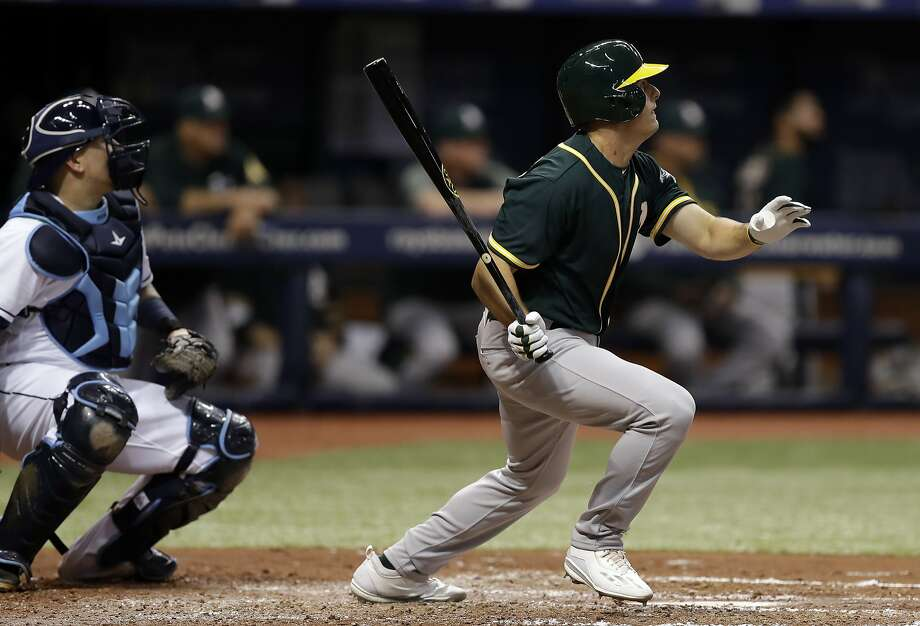 Oakland Athletics' Jaycob Brugman, making his major league debut, flies out to Tampa Bay Rays center fielder Colby Rasmus during the third inning of a baseball game Friday, June 9, 2017, in St. Petersburg, Fla. (AP Photo/Chris O'Meara) Photo: Chris O'Meara, Associated Press