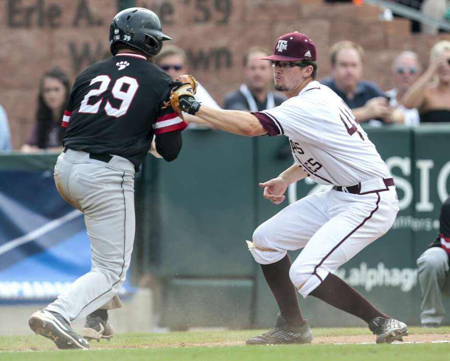 Davidson catcher Jake Sidwell (29) is tagged out by Texas A&M infielder George Janca (44) going back to third on a failed bunt attempt during the 12th inning of an NCAA baseball Super Regional at Olsen Field at Blue Bell Park on Friday, June 9, 2017, in College Station. Texas A&M beat Davidson 7-6 in 15 innings. ( Brett Coomer / Houston Chronicle ) Photo: Brett Coomer/Houston Chronicle