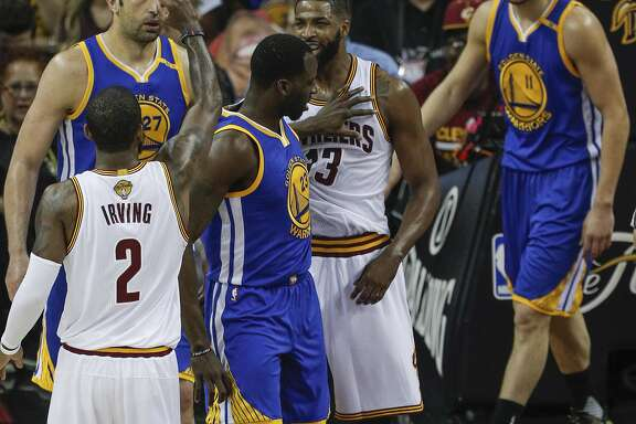 Golden State Warriors' Draymond Green gives Cleveland Cavaliers' Tristan Thompson a shove in the first quarter during Game 4 of the 2017 NBA Finals at Quicken Loans Arena on Friday, June 9, 2017 in Cleveland, Ohio