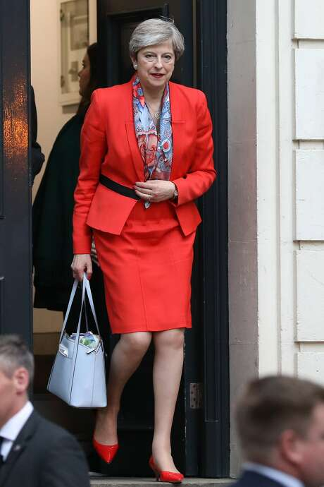 Theresa May, U.K. prime minister and leader of the Conservative Party, leaves the Conservative Party campaign headquarters in London Friday. May's future as Britain's prime minister was thrown into doubt after her gamble to call an early election backfired spectacularly shortly before Brexit negotiations are due to start. MUST CREDIT: Bloomberg photo by Chris Ratcliffe. Photo: Chris Ratcliffe, Bloomberg