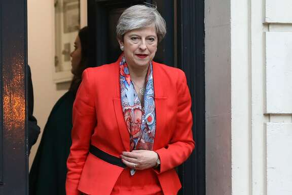 Theresa May, U.K. prime minister and leader of the Conservative Party, leaves the Conservative Party campaign headquarters in London Friday. May's future as Britain's prime minister was thrown into doubt after her gamble to call an early election backfired spectacularly shortly before Brexit negotiations are due to start. MUST CREDIT: Bloomberg photo by Chris Ratcliffe.