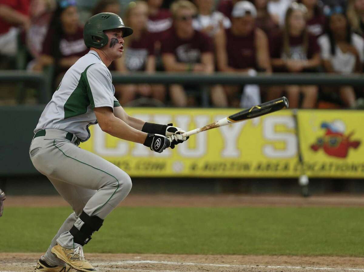 Reagan's Cade Bormet hits a single against Round Rock during the Class 6A UIL state semifinal at Dell Diamond in Round Rock on June 9, 2017.