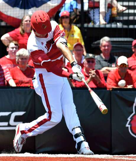 Louisville third baseman Drew Ellis connects for a three-run home run during the fifth inning Friday in the win over Kentucky at Jim Patterson Stadium. Photo: Timothy D. Easley, FRE / FR43398 AP