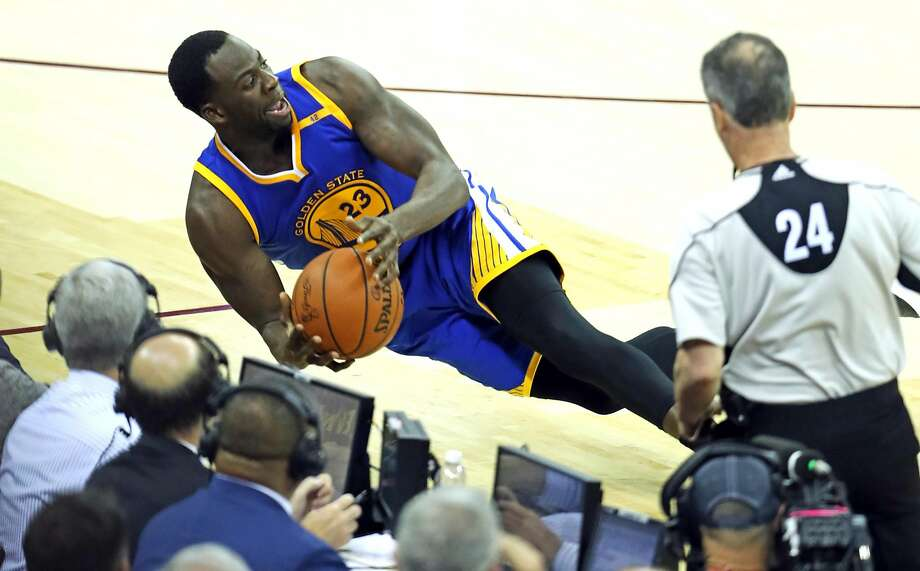 Golden State Warriors' Draymond Green tries to save  a ball from going out of bounds in 4th quarter of Cleveland Cavaliers' 137-116 win in Game 4 of NBA Finals at Quicken Loans Arena in Cleveland, Ohio, on Friday, June 9, 2017. Photo: Scott Strazzante, The Chronicle
