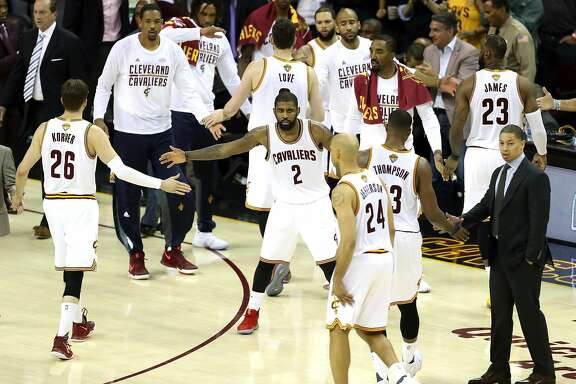 Cleveland Cavaliers' Kyrie Irving welcomes team back to bench during 4th quarter of Cavaliers' 137-116 win over Golden State Warriors in Game 4 of NBA Finals at Quicken Loans Arena in Cleveland, Ohio, on Friday, June 9, 2017.
