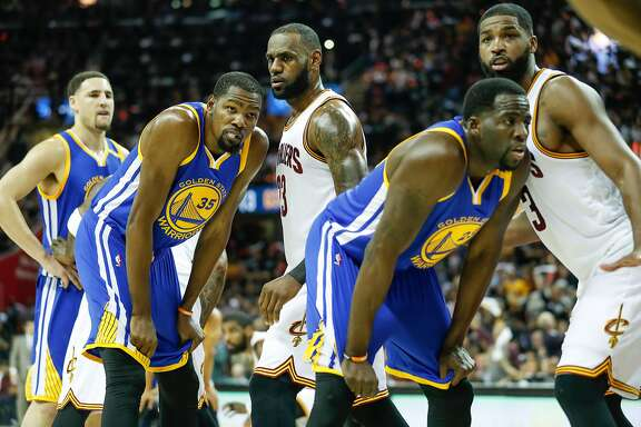 Golden State Warriors' Klay Thompson, Kevin Durant, Draymond Green and Cleveland Cavaliers' LeBron James and Tristan Thompson are seen in the first quarter during Game 4 of the 2017 NBA Finals at Quicken Loans Arena on Friday, June 9, 2017 in Cleveland, Ohio
