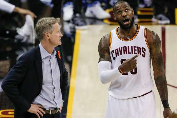 Golden State Warriors' Head Coach Steve Kerr and Cleveland Cavaliers' LeBron James talk in the first quarter during Game 4 of the 2017 NBA Finals at Quicken Loans Arena on Friday, June 9, 2017 in Cleveland, Ohio