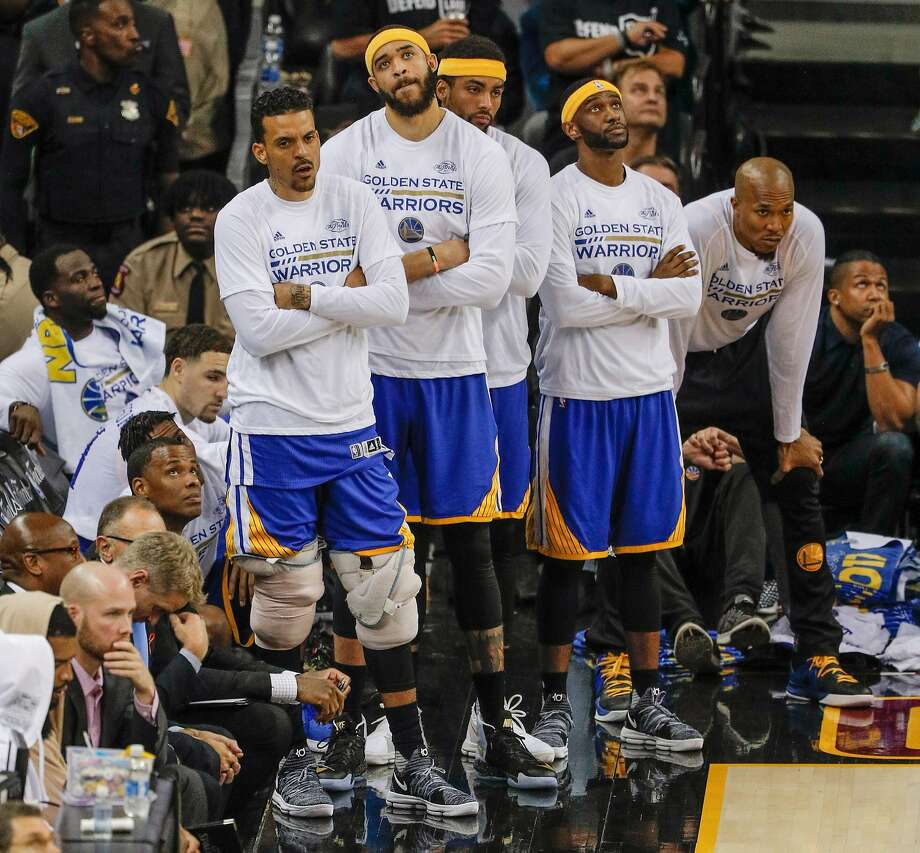 Golden State Warriors' Kevin Durant, Stephen Curry, and Shaun Livingston watch the final moments of Game 4 of the 2017 NBA Finals at Quicken Loans Arena on Friday, June 9, 2017 in Cleveland, Ohio Photo: Carlos Avila Gonzalez, The Chronicle