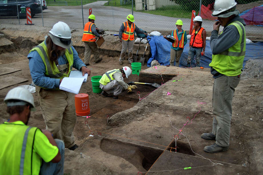 BRITTNEY LOHMILLER | blohmiller@mdn.net Employees of ASC Group, a firm that specializes in archaeological investigations based in Columbus, Ohio, work at the archaeological site near the M-20 bridge Tuesday afternoon.