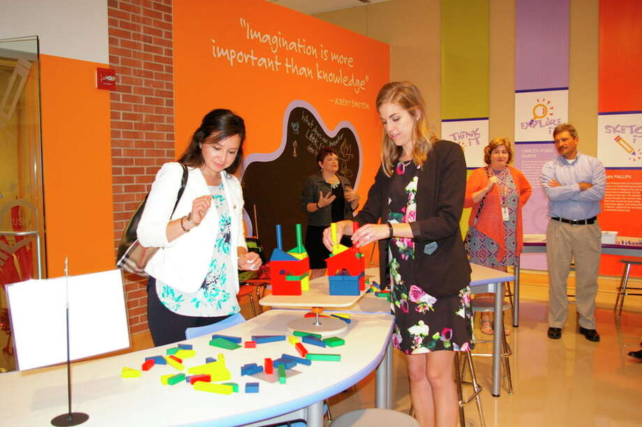 Before the ribbon-cutting ceremony for the Spark!Lab Smithsonian Friday afternoon, Lucy Pagán of Midland and Megan Manning of Bay City succeeded at the Towering Teeter Table Challenge. Pagán and Manning represented the DeVos Graduate School at Northwood University at the event.
