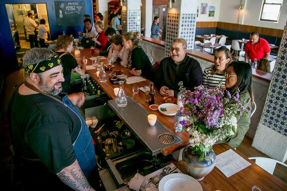 Chef Telmo Faria talks with customers at the bar at Uma Casa in San Francisco, Calif., on June 9th, 2017.