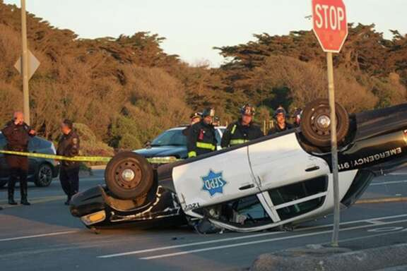 Two San Francisco police officers were injured Friday evening after a collision in their patrol car on the Great Highway near the city's Richmond District.