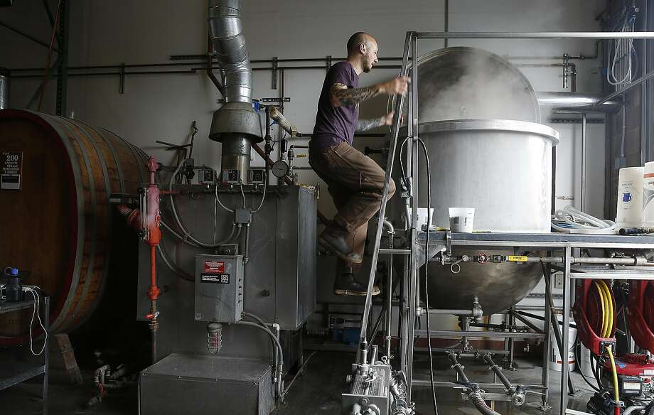 Head brewer Jon Drinnan works in the brewery at Sante Adairius Rustic Ales in Capitola. Photo: Liz Hafalia, The Chronicle