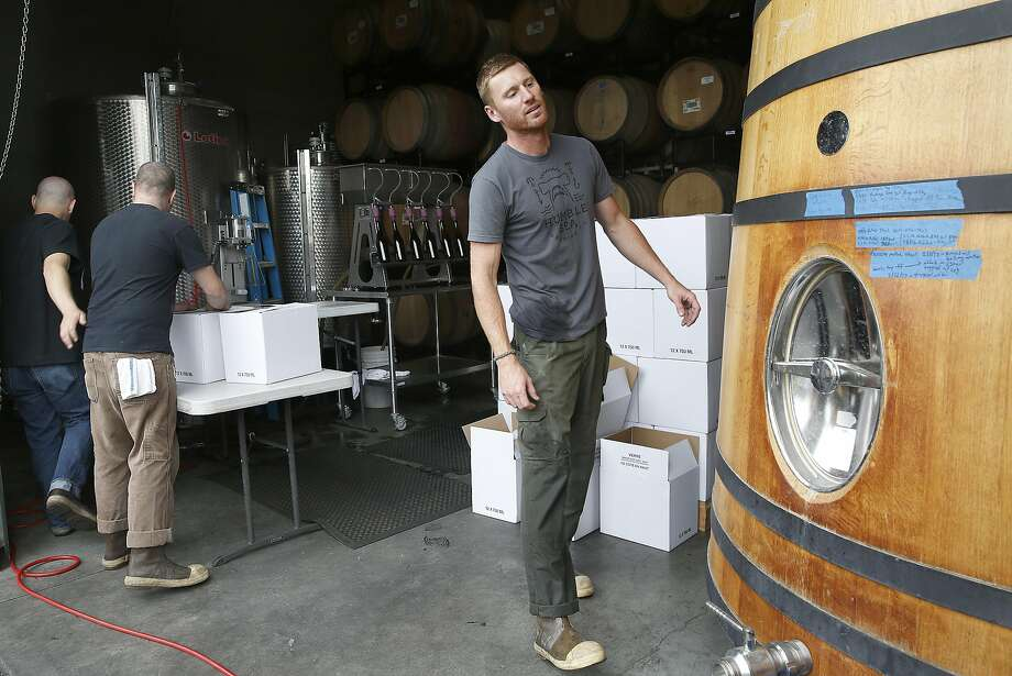 Cellar man Clint Reed (right) packaging beer at Sante Adairius Rustic Ales in Capitola. Photo: Liz Hafalia, The Chronicle