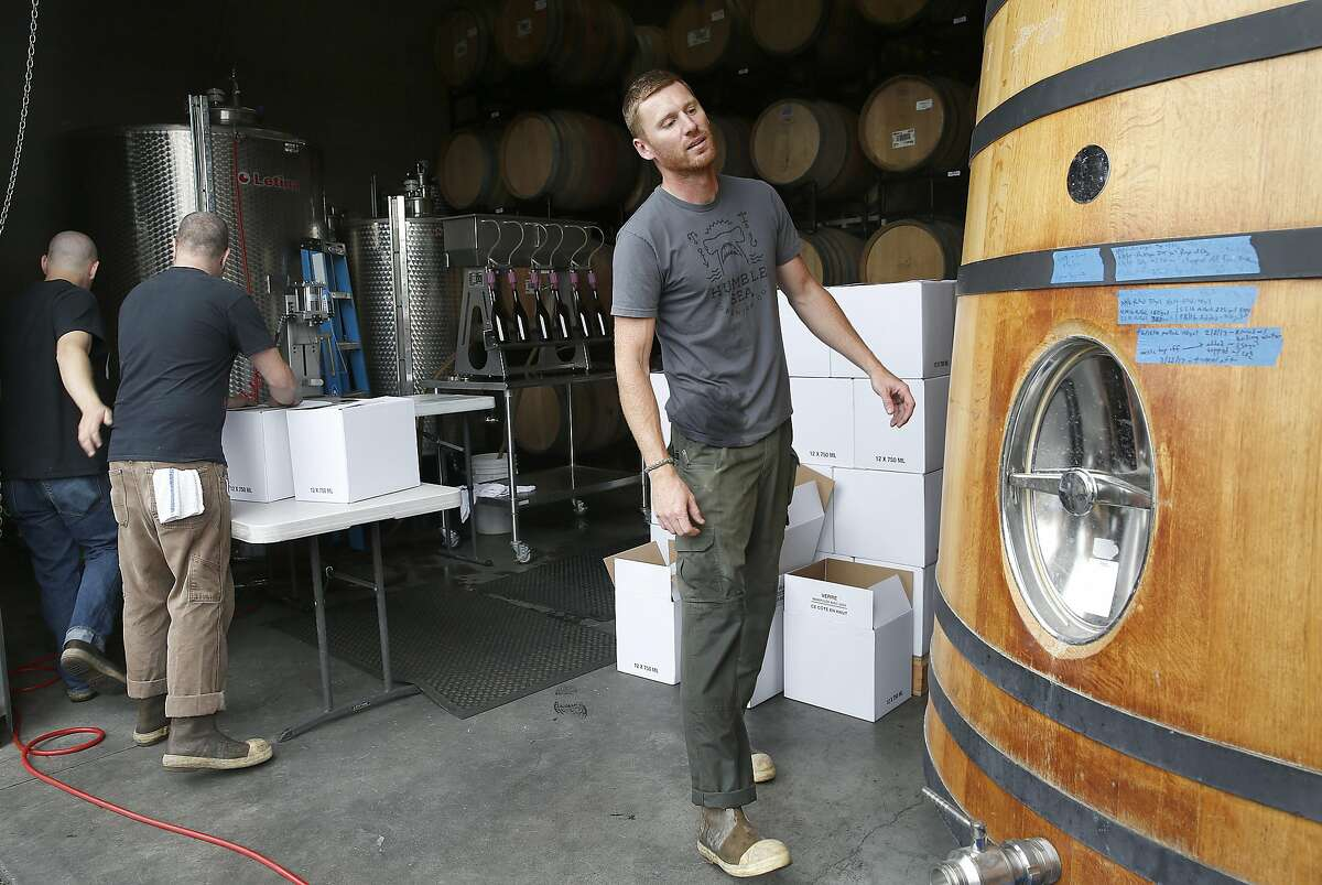 Cellar man Clint Reed (right) packaging beer at Sante Adairius Rustic Ales on Thursday, June 8, 2017, in Capitola, Calif.