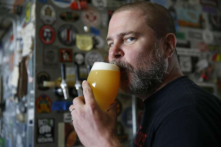 Assistant brewer Danny Buzzard tastes a Fly Leaf at Sante Adairius Rustic Ales on Thursday, June 8, 2017, in Capitola, Calif.