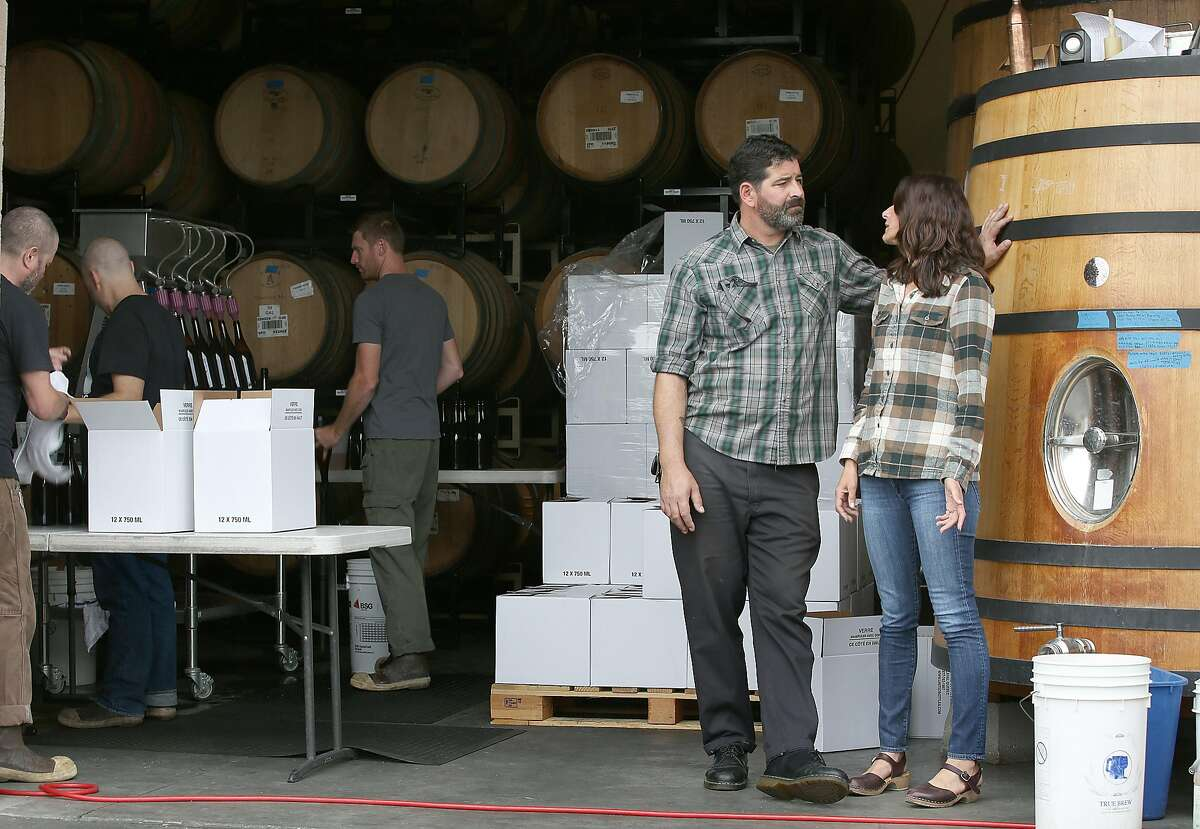 Brewery co-owners Tim Clifford and Adair Paterno (right) next to a foudres in the bottling area of Sante Adairius Rustic Ales on Thursday, June 8, 2017, in Capitola, Calif.