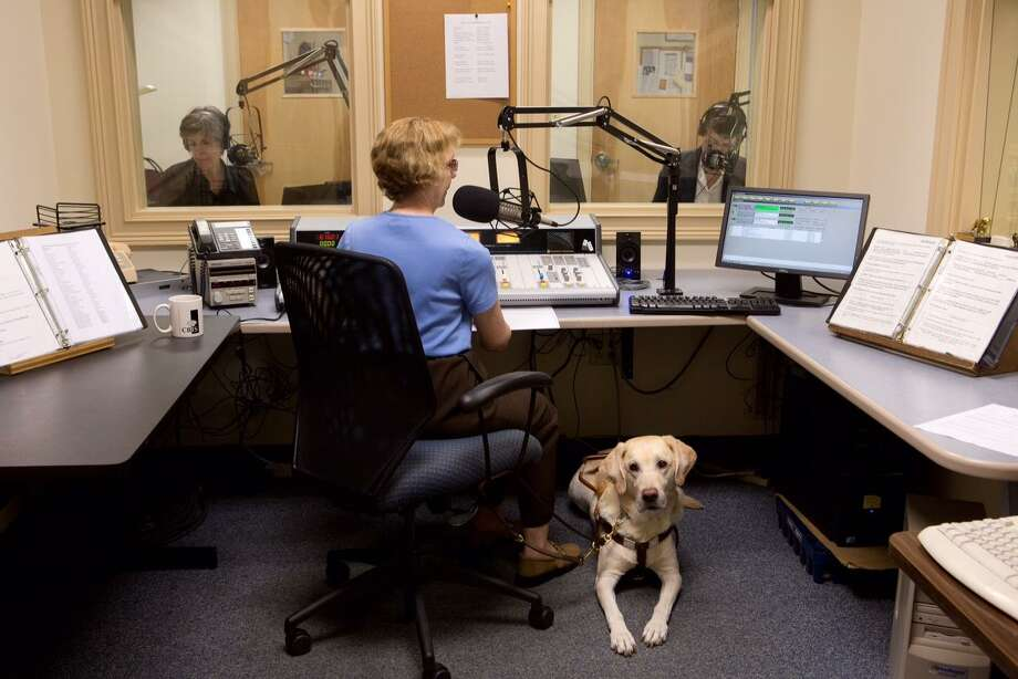CRIS volunteer and listener, Diane Duhaime, produces a live afternoon news program each week with CRIS volunteer readers Sue Carey, left, and Ruth Bowman. Pictured with Duhaime is her guide dog Iroc. Photo: Contributed Photo / Steve Laschever / Steven Laschever photography