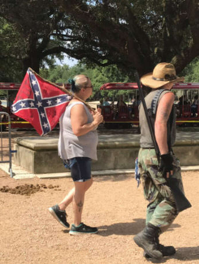 A number of protesters, many armed with guns and wearing camouflage or makeshift armor, rallied at Hermann Park in Houston on Saturday, June 10, 2017. Photo: Evan Mintz ,  Houston Chronicle