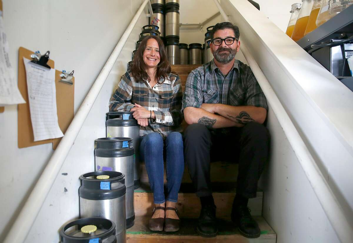 Brewery co-owners Adair Paterno (left) and Tim Clifford (right) at the brewery in Sante Adairius Rustic Ales on Thursday, June 8, 2017, in Capitola, Calif.