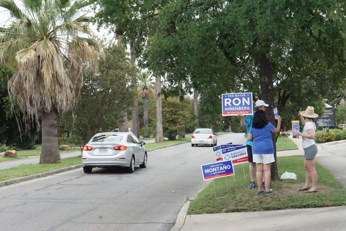Ron Nirenberg supporters received honks from passing motorists outside Laurel Heights United Methodist Church Saturday June 10, 2017.