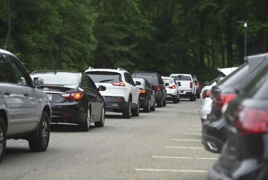 Student cars form a long line waiting to leave the parking lot after dismissal at Greenwich High School in Greenwich, Conn. Thursday, June 8, 2017. Photo: Tyler Sizemore / Hearst Connecticut Media / Greenwich Time