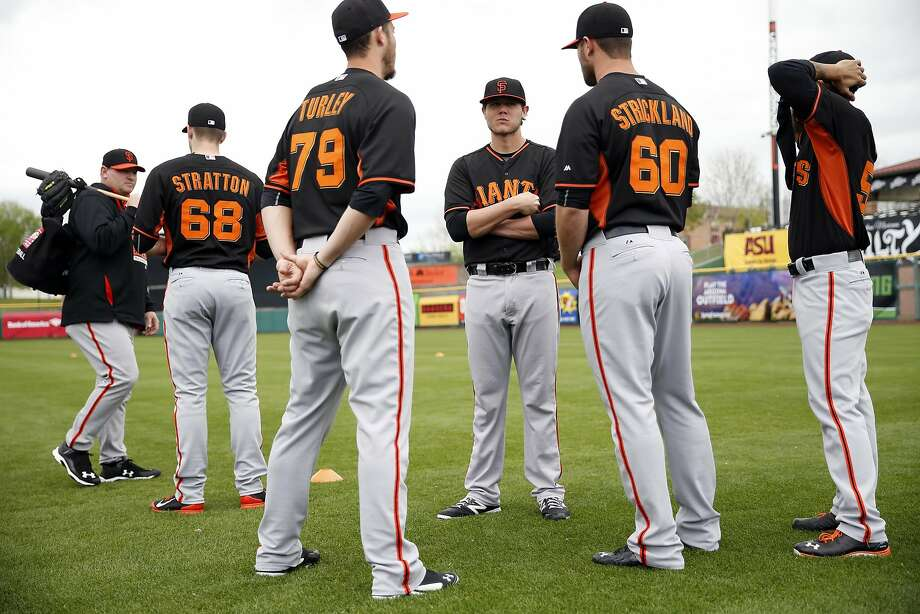 San Francisco Giants' Steven Okert (center) talks with Nik Turley (79), Hunter Strickalnd (60) and Sergio Romo (right) during Spring Training at Scottsdale Stadium in Scottsdale, Arizona, on Sunday, March 1, 2015. Photo: Scott Strazzante, The Chronicle