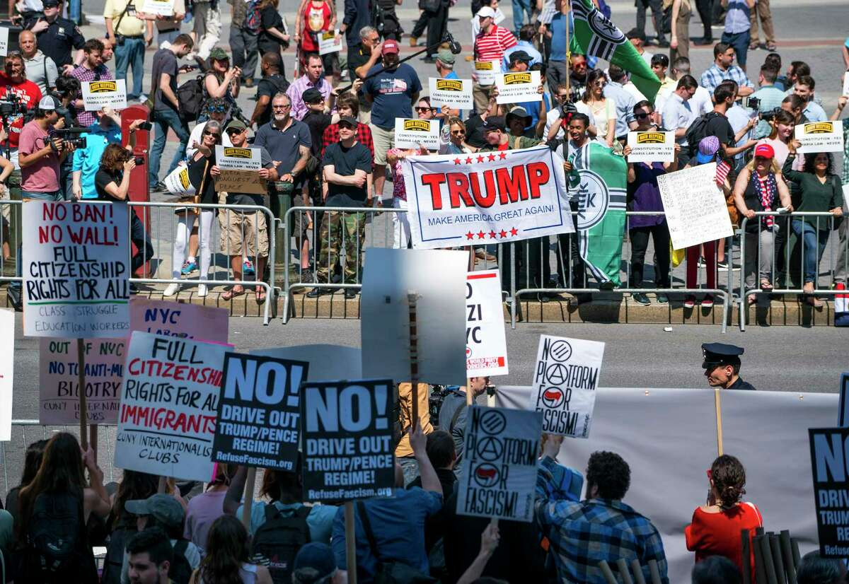 Demonstrators against Islamic law (background) gather in New York Saturday as counter demonstrators line up across Centre St., foreground. Marches against Islamic law were planned in more than two dozen cities across the United States Saturday.
