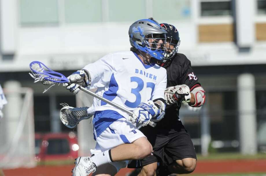 Darien's Henry West in action as Darien High School faces New Canaan High in the Class M State Semifinals at Roger Ludlowe in Fairfield Tuesday June 8, 2010. Darien won 5-4 in double overtime. Photo: Keelin Daly / Greenwich Time
