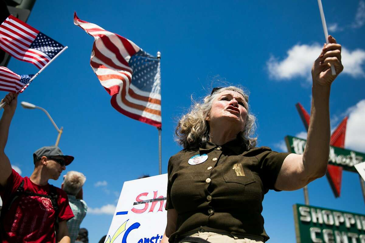 Alice Hoagland protests with the Anti-Sharia law demonstrators on the corner of Winchester Boulevard and Stevens Creek Boulevard in Santa Clara, Calif. Saturday, June 10, 2017.