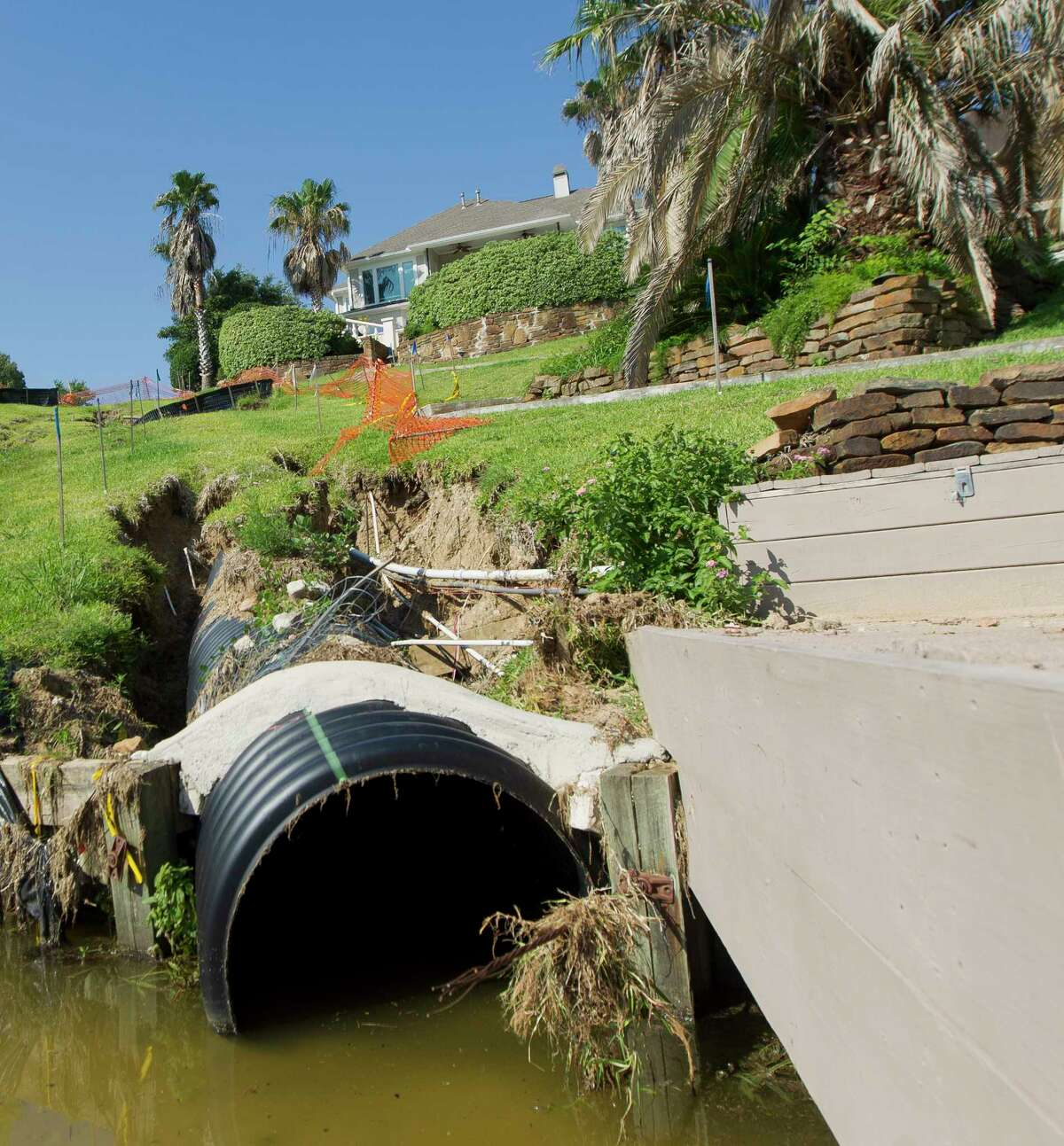 A drainage line two years ago damaged the not only the easement between two homes, but has also spread into some residents' property.