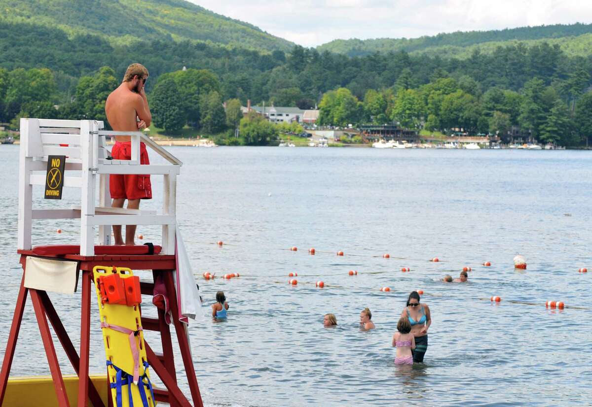 A lifeguard surveys the lake on Friday, Aug 21, 2015, at Million Dollar Beach in Lake George, N.Y. (Phoebe Sheehan/Special to The Times Union)