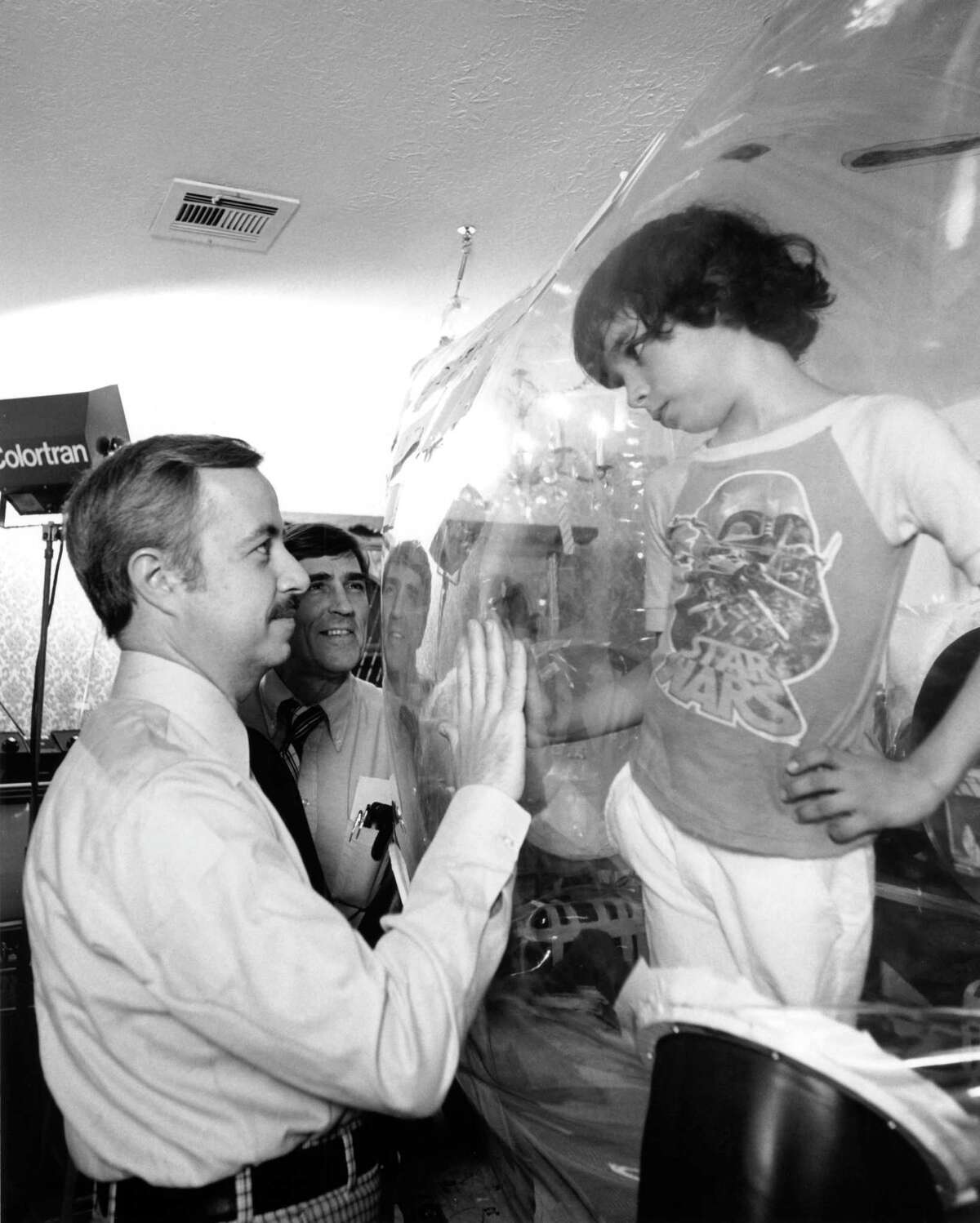 """Dr. William Shearer visits with his patient, """"Bubble Boy"""" David Vetter, at Texas Children's Hospital in 1979. David died in 1984 at age 12."""