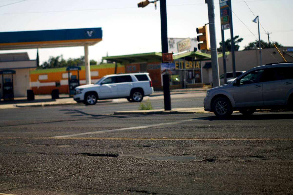 Potholes and pavement patches visible on Midkiff Road near the intersection of Andrews Highway photographed June 10, 2017. James Durbin/Reporter-Telegram