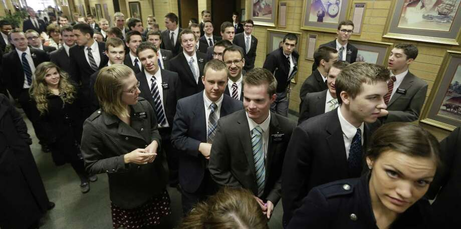 FILE - In this Jan. 8, 2013, file photo, Mormon missionaries walk through the halls at the Missionary Training Center in Provo, Utah. The Mormon church for the first time ever is sending out a survey to the religion's 62,000 missionaries to gauge safety conditions for young men and women serving proselytizing missions around the world. (AP Photo/Rick Bowmer, File) Photo: Rick Bowmer, STF / Copyright 2017 The Associated Press. All rights reserved.