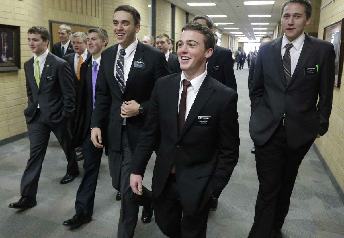 Mormon missionaries walk through the halls at the Missionary Training Center in Provo, Utah.