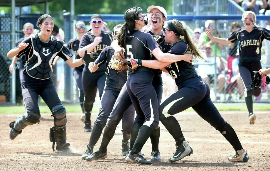 Joel Barlow's Caitlin Colangelo, Briana Marcelino and Taylor Macchia celebrate their 4-2 win over Torrington in the Class L championship at West Haven High School on Saturday. Photo: Arnold Gold / Hearst Connecticut Media / Connecticut Post