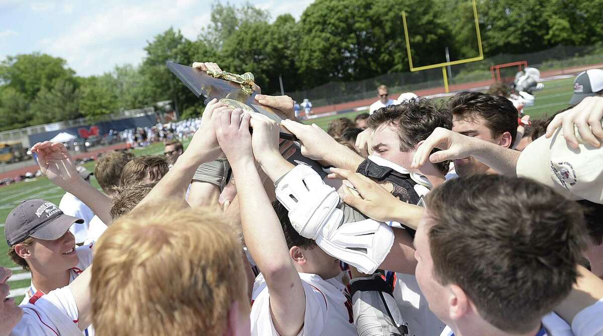 The New Canaan lacrosse team celebrates after winning Saturday's Class M Boys Lacrosse final between Daniel Hand and New Canaan at Brien McMahon High School in Norwalk, Conn., on Saturday, June 10, 2017.