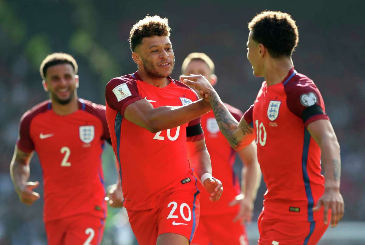 England's Alex Oxlade-Chamberlain, center, celebrates after scoring the opening goal during the World Cup Group F qualifying soccer match between Scotland and England at Hampden Park, Glasgow, Scotland, Saturday, June 10, 2017. (AP Photo/Scott Heppell)