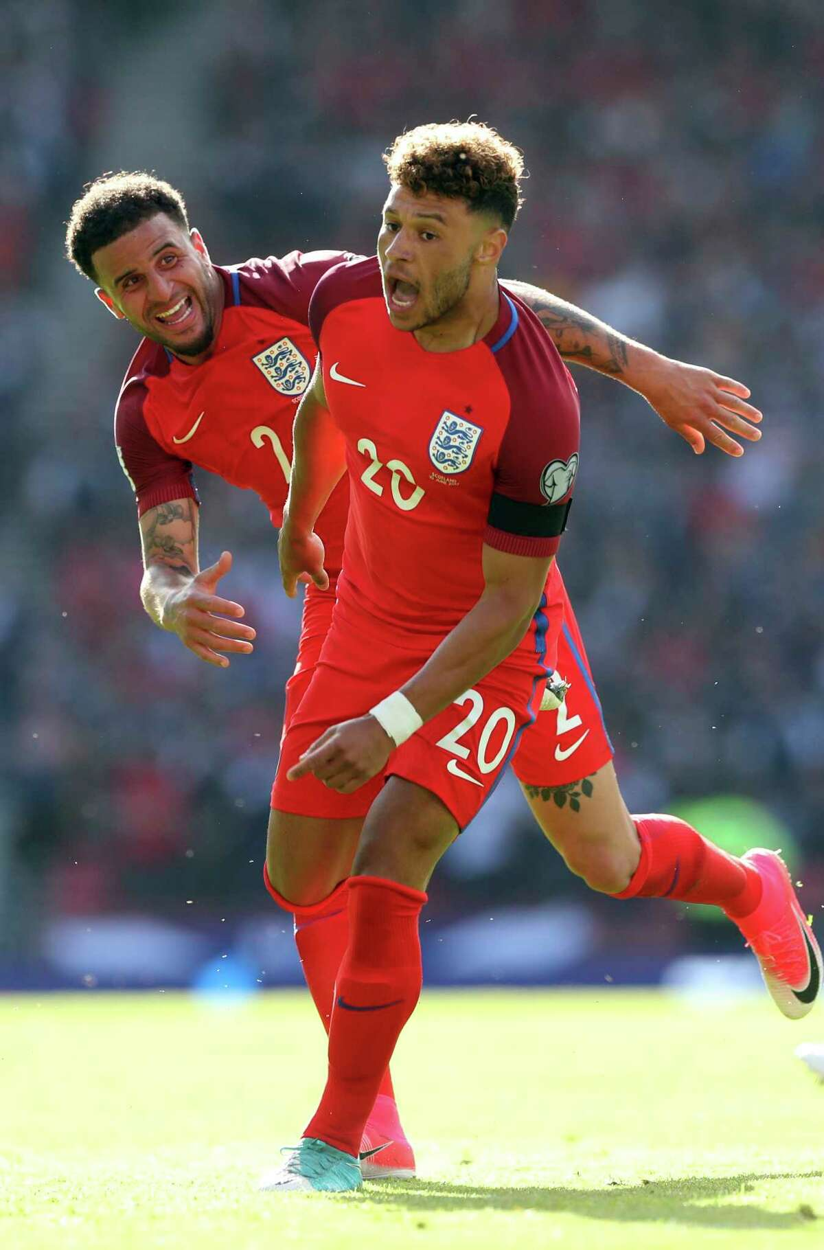 England's Alex Oxlade-Chamberlain, right, celebrates after scoring the opening goal during the World Cup Group F qualifying soccer match between Scotland and England at Hampden Park, Glasgow, Scotland, Saturday, June 10, 2017. (AP Photo/Scott Heppell)