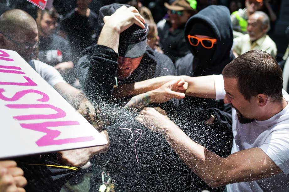 "Pepper spray from police hits clashing demonstrators on Occidental Avenue South following an ""anti-Sharia"" protest at City Hall in Seattle, Saturday, June 10, 2017. Photo: GRANT HINDSLEY, SEATTLEPI.COM / SEATTLEPI.COM"