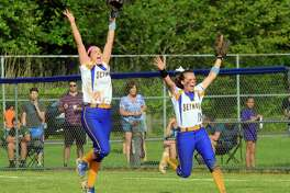 Seymour second baseman Shari Minalga, left, and teammate Becca Johnson leap into the air in celebration following their 4-3 win over North Branford in Class M softball championship on Saturday. Minalga caught final out on a pop fly.