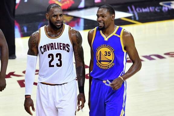 LeBron James, left,  of the Cavs and Kevin Durant of the Warriors at one point in their careers went to good teams to increase their chances for a title. Michael Jordan never did.